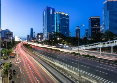 Traffic light trail in Jakarta business district highway at night in Indonesia capital city